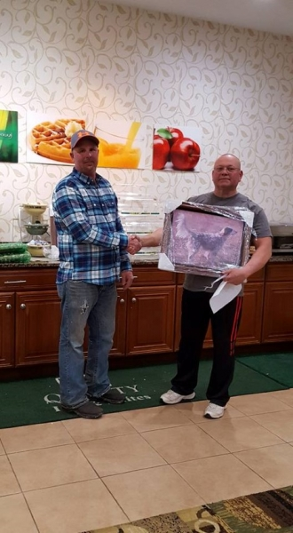 Bill Butler receiving the Club Championship portrait for Sage from Tim Powell