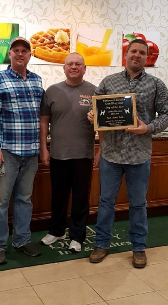 Nate Dixon receiving Derby of the Year award 2017-2018 — with Timothy Powell and Billy Butler Sr..