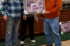 Bill Phelps receiving the Club Championship portrait for Daisy from Bill Butler and Tim Powell — with Timothy Powell and Harry Lyness.