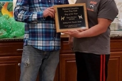 Timothy Powell receiving Dog of the Year Award 2017-2018 from President Bill Butler — with Timothy Powell and Billy Butler Sr..