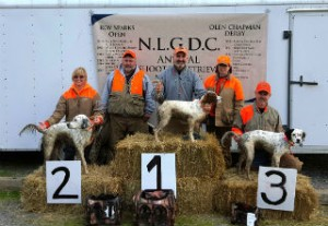 Saturday Puppy winners: 3rd Kellie Leaming with Dallas, Judge Jerry Idlett, 1st Bob Wilson with Gravy, Judge Caren Mansfield, 3rd Rafe Millard with Remi